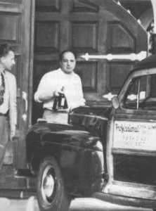 1947, Ralph Capone giving drinks to reporters.  Inside the building lays Al Capone, dying.