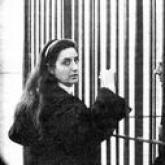 The daughter of Raffaele Cutolo standing in front of his cell.