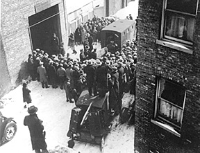 Body's of the victims from the St.Valentine's Day Massacre are carried outside.